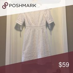 White Crochet floral Design Dress White dress with a crochet lace floral design, size 2, in excellent condition with long zipper in the back! ANTONIO MELANI Dresses Midi