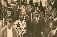 In the 1960s Sister Mary Raynold, walked with Dr. Martin Luther King Jr. en route to a memorial service for Rev. James J. Reeb at the Dallas County Courthouse Steps in Selma, Alabama. Throughout his campaign, other BVMs marched alongside Dr. King and supported the civil rights movement.