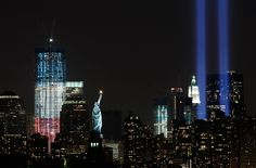 """The """"Tribute in Light"""" shines above lower Manhattan, the Statue of Liberty, and One World Trade Center in New York. 2011 marks the 10th anniversary of the Sept. 11, 2001 attacks on the United States."""