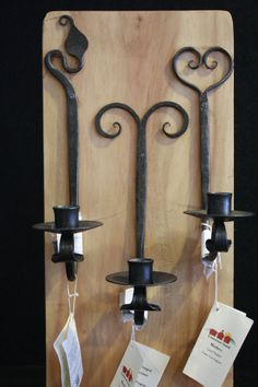 These hand-forged candle sconces come in various designs and are perfect for adding that rustic touch to your home!