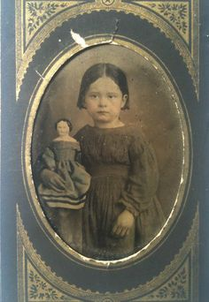 Civil War Era Tinted Tintype of Girl with her China Doll in Blue Dress.