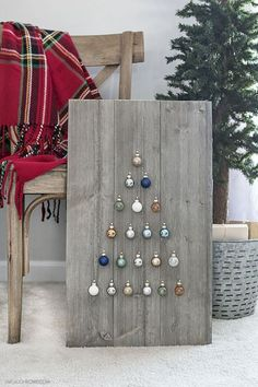 Christmas Tree Wall Art - Step by step instructions on how to build a simple, rustic Shiplap Ornament Display. A great addition to your rustic, farmhouse holiday decor -- and you can change out the ornaments!Hey there people! Are you getting in the holida Noel Christmas, Christmas Signs, Christmas Projects, Christmas Ornaments, Holiday Signs, Christmas Music, Christmas Movies, Christmas Wall Art, Homemade Christmas Decorations