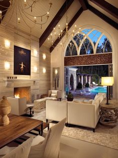 Yes please, love the chandeliers and stained wood beams not to mention that gorg arched window and tile wall/fireplace... love love love