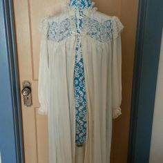 Vintage Lacy Peignoir So pretty soft!  Still very practical.  Probably from the 1950s.  This item is also available at Antiques and Things, 4710 Central Ave SE, Albuquerque, NM 87108, Booth #19. As a result please allow a few days for shipping Radcliffe Intimates & Sleepwear Robes