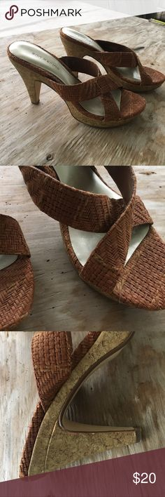 Crisscross brown cork heels. I'm not sure of the material on the brown part but the heel itself is cork. Cute for summer or spring. Worn a few times Ann Marino Shoes Heels
