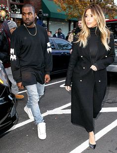 Kanye West and Kim Kardashian wear complimentary — but not matching! -- looks as they leave Hot 97's radio station.