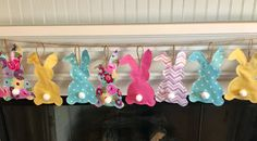 This adorable fabric Floppy Ear Bunny Bunting in pastel colors is perfect for your Easter Decor! The bunting can be hung on a wall, over a window or doorway, and a fireplace mantel. It will add that special touch to your celebration.  Bunnies are constructed of 5 different cotton fabrics. The fabrics chosen are in pastels such as lavender, aqua, yellow, pink, and multi floral. Backs of bunnies are made from warm and natural quilt batting. Each bunny is top stitched for a quilted appearance…