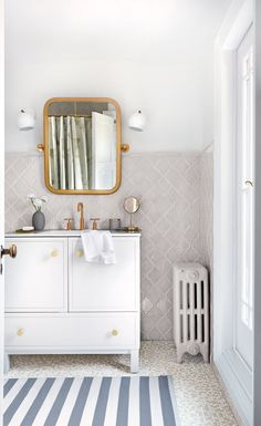 A dated bathroom receives a modern makeover that pays homage to its 1920s beginnings.   Image: Donna Griffith   Designer: Stacy Begg   Styling: Ann Marie Favot #StyleatHome #bathrooms #vintage