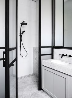 Marble bathroom with strong black accents