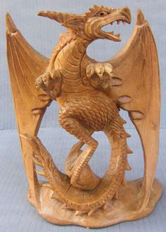 Dragon wood carving made of suar wood | wooden dragon made in Bali Indonesia