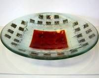 fused glass bowl, 13 inches, clear background with a dark red square. Inlaid with copper wire and square brushed steel