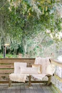 Outdoor Lounge Area with Pillows + Blankets | Magnolia Plantation Carriage House Wedding by Charleston wedding photographer Dana Cubbage