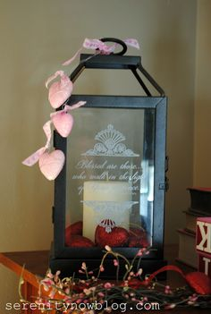 Valentine lantern - white candle with red heart ornaments