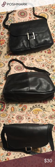 """Wilsons Leather Laptop Bag WILSONS LEATHER black leather laptop bag. Adjustable strap. Outer zipper pocket. Brushed silver buckle with magnetic snap closure. Laptop pocket is 16"""" wide. Overall bag size: length 17"""" x width 4"""" x height 13"""". Wilsons Leather Bags Laptop Bags"""