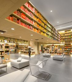 Saraiva Bookstore - Books are arranged by colour rather than by title on the upper shelves of this bookshop in Rio de Janeiro designed by São Paulo firm Studio Arthur Casas