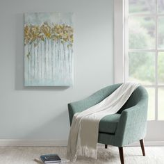 Add style and sophistication to your living room with Minted Forest. The art piece features a beautiful and calming seafoam color and has hand applied gold foiling for added dimension.