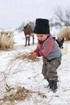 Romanian rural life ~ Photo by Marian Mocanu Kids Around The World, People Around The World, Precious Children, Beautiful Children, Little People, Little Boys, I Love Winter, Winter Snow, Snow Scenes
