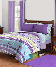 Sweet dreams! This candy-colored comforter is embellished with a pattern of hearts and butterflies that will make a bedroom look extra special.