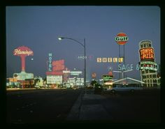 The neon lights of the Las Vegas Strip in 1968 - Flamingo Hotel, Sage and Sand, Caesar's, Leaning Tower of Pizza.