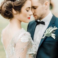 The perfect moment... What a wonderful capture by @naomi.kenton.photography So much pretty and attention to detail. I love the way the grooms buttonhole reflects the brides hairpiece and that gorgeous lace... #Repost @naomi.kenton.photograph