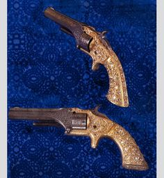 """""""Model One"""" handguns were created in the year of the inception of Smith & Wesson (c. 1857). The handguns comprise pure gold handles set with Russian old-mine cut diamonds, steel cylinders and barrels engraved by L.D. Nimschke."""