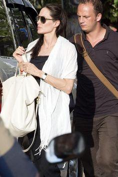 Angelina Jolie wearing Versace Aviator Sunglasses and Cuyana Oversized Carryall Tote in Cream