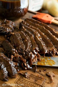 Slow Cooker Barbecue Beef Brisket - A super simple way to prepare fall-apart-tender beef brisket! And the sauce is amazing too!