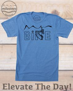California home shirt by Milostees- Original mountain bike illustration of a cyclist descending the Golden Bear State for an epic ride. Hand screen printed art on a heather blue tee by American Apparel made with a soft cotton, polyester blend that is awesome for casual San Diego days or riding trails in the Redwoods. Elevate the day wear a more comfortable you! $21.99, free shipping in the USA. #CAShirt #MTBShirt