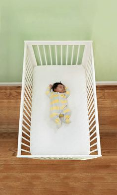 infant in safe crib environment  No bumper pads, no toys, no pillows! Love!