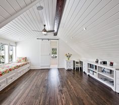 Attic space, one side dormer-ed, window seats.