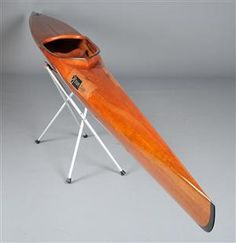 Struer racing kayak, model Power, hand-built mahogany and wengé kayak. Produced by Struer Kajak A/S, Denmark. L. 520 cm. W. 43 cm. Cockpit 98.5 cm x 37 cm. A few scratches, marks. The stands shown in the photos are not included.