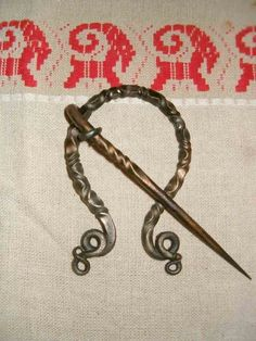 Penannular Cloak Kilt Pin Viking Scottish Celtic Brooch, via Etsy.