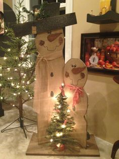 Handmade and hand painted Mr. & Mrs. Snowman make a great focal point for your porch or in front of your fireplace.
