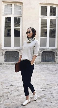 A Cream Sweater, Black Pants, Loafers, and a Neck Scarf