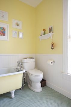 Cheery yellow bathroom walls would work great for the girls.