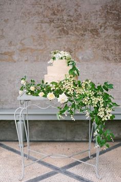 Or go bare when it comes to a tablecloth and opt for a sumptuous bed of botanicals to display your with your cake, ideal for an English country theme.Related: 25 Creative Ways to Show Off Your Wedding Cake