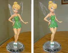My tinkerbells on pinterest tinkerbell precious moments dolls and glitter dress - Tinkerbell statues ...