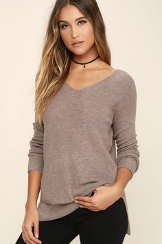 The Casual Friday Taupe Sweater is always ready for the weekend! Soft and slightly sheer stretch knit with pierced details sweeps across a V-neck and back, into long sleeves with ribbed cuffs and a banded, notched hem.