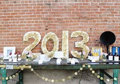 """spell out """"retro on the runway"""" in cut out letters and paste gold tinsels to them"""