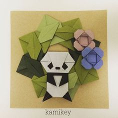 """Jul. 10. 2015 以前の投稿で頭だけ登場していたパンダ君に合う身体ができました!川村みゆきさんの「正8角形のタイル」を参考にしています折り方はYouTube で「折り紙 パンダ kamikey 」で検索してみてください 笹リースと二重のお花も私の創作です^ ^ * Panda tutorial on YouTube search """"origami panda kamikey """"  #origami#折り紙#おりがみ#ハンドメイド"""