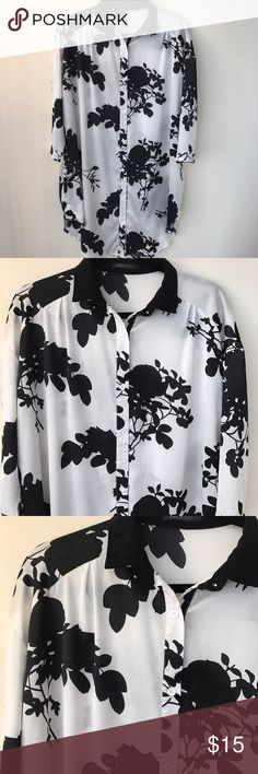 Black and White Floral Silky Shirt Tunic Bold black Floral pattern in white silky background tunic. Button down. 3/4 sleeves. This tunic is meant to wear as a loose fitting top. Tops Tunics