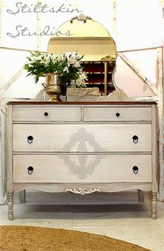 StiltskinStudios -The body is painted in Amy Howard Home's One Step Paint in Luxe Grey and the details, as well as the two large drawers are painted in Bauhaus Buff
