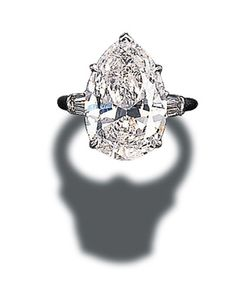 A SINGLE-STONE DIAMOND RING, BY HARRY WINSTON Set with a pear-shaped diamond weighing 5.05 carats to the tapered baguette-cut diamond shoulders and platinum hoop 5.05 carats