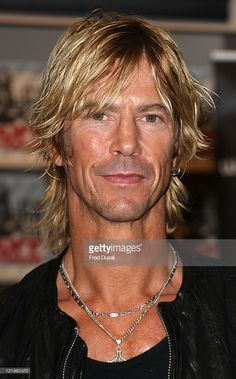 News Photo : Duff McKagan signs copies of his new...