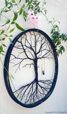 Repurposed bicycle wheel tree art, by A Crafty Mix, featured on Funky Junk Interiors