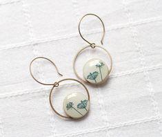 Lovely earrings. I really like the design on these.