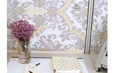 """Cover cubicle panels with """"wallpaper."""" To attach the fabric to the panels, begin pinning (with sewing pins) from the middle, moving outward. Fold the edges over and pin in place. If you're picky about edges, use a cotton ribbon to finish them off. Cute Cubicle, Work Cubicle, Cubicle Ideas, Cubicle Decorations, Office Cubicle Design, Cubicle Makeover, Office Makeover, Cubicle Wallpaper, Buzzfeed Gifts"""