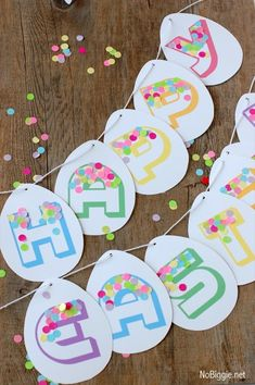 Happy Easter Banner (free printable download). A fun DIY egg-shaped garland. A simple way to add festive decor to your Easter gathering - NoBiggie.net