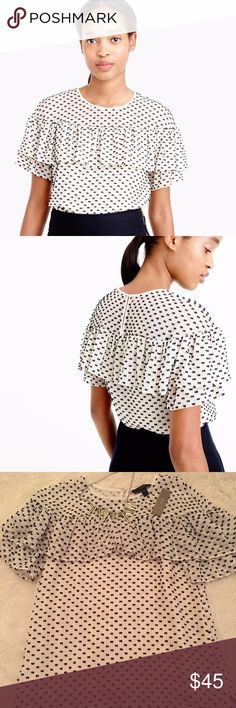 J. Crew Edie Textured Clip Dot Top Ruffle Blouse Super girly silk blouse with a ruffle across the front and dots (that look like bows) all over the front and back. This top is very Blair Waldorf inspired. Style number F8992. J. Crew Tops Blouses