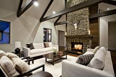 exposed beams and schist fireplace